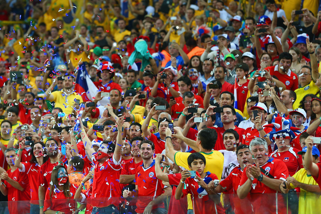 . Chile fans throw confetti at the start of the 2014 FIFA World Cup Brazil Group B match between Chile and Australia at Arena Pantanal on June 13, 2014 in Cuiaba, Brazil.  (Photo by Clive Brunskill/Getty Images)