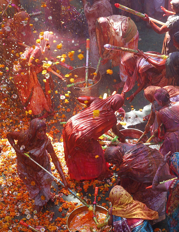 . Indian widows and locals  throw petals and spray colored water while participate in the Holi festival in Vrindavan, Uttar Pradesh, India, March 14, 2014.  EPA/HARISH TYAGI