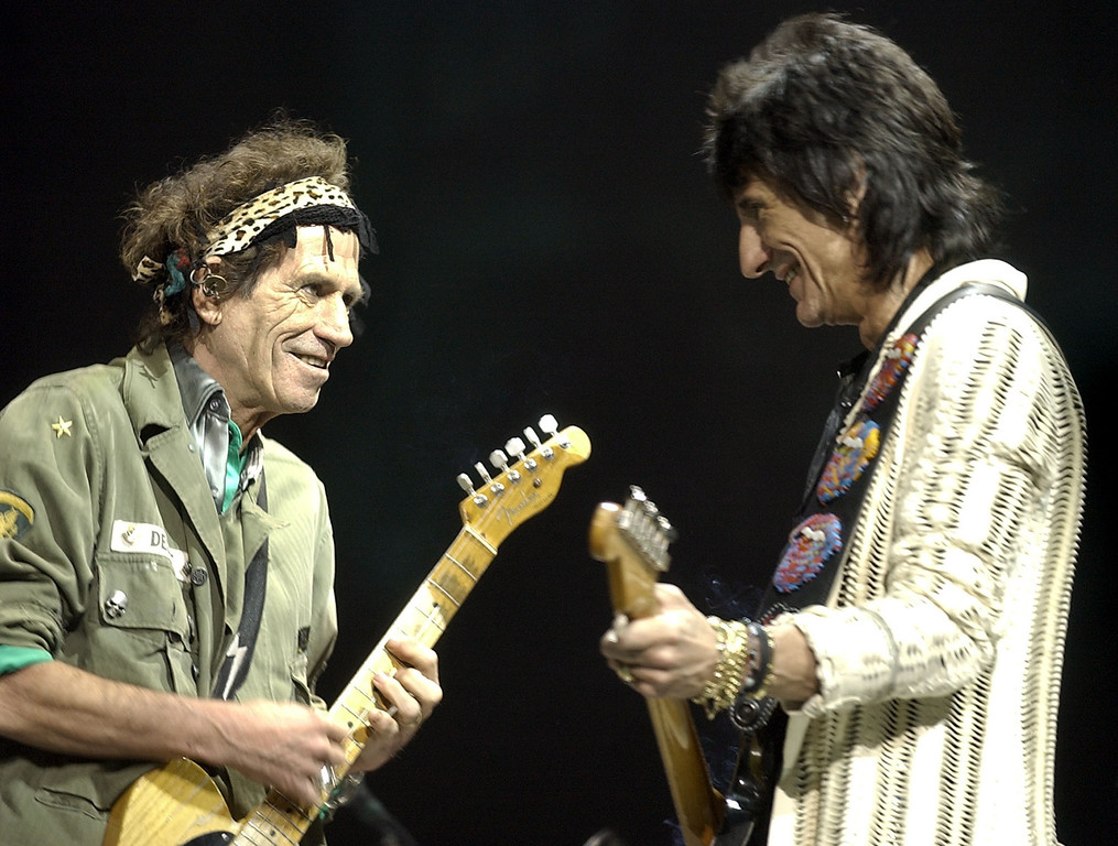 . Ron Wood, right, and Keith Richards, of the Rolling Stones perform Tuesday, Oct. 22. 2002, in Sunrise, Fla. (AP Photo/ Steve Mitchell)