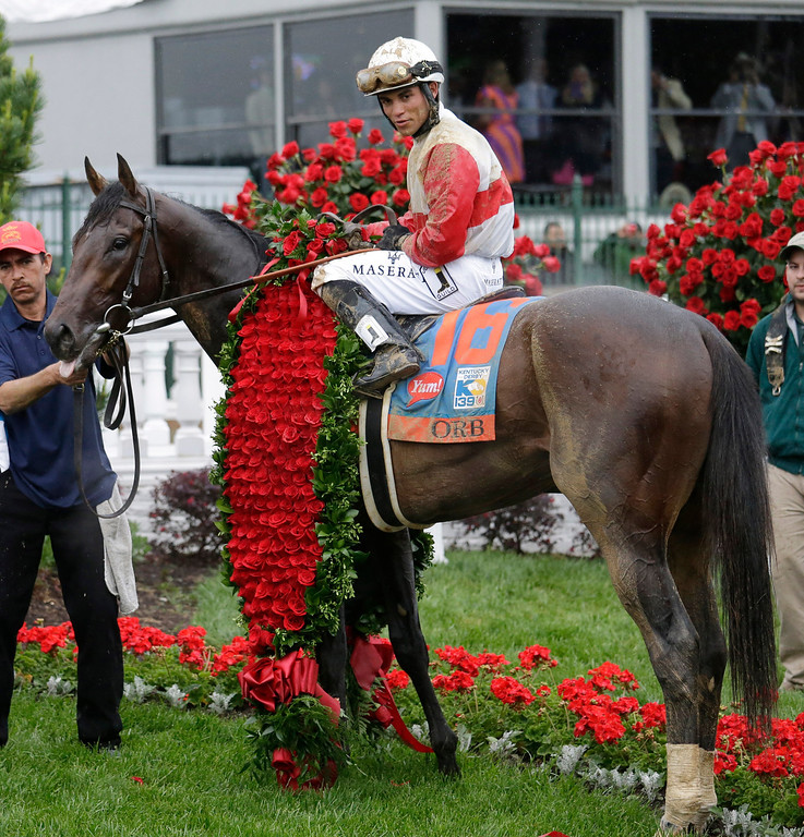 . Joel Rosario sits on Orb in the winners circle after winning the 139th Kentucky Derby at Churchill Downs Saturday, May 4, 2013, in Louisville, Ky. (AP Photo/J. David Ake)