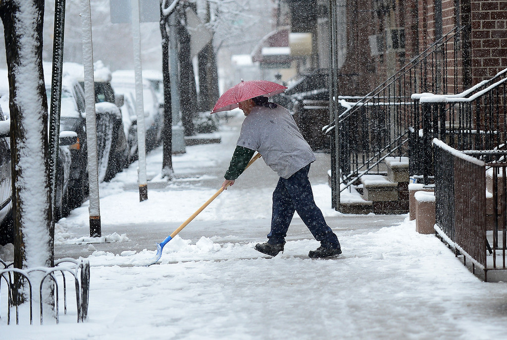 . A man clears snow as a snow storm hits New York, March 8, 2013. AFP PHOTO/EMMANUEL  DUNAND/AFP/Getty Images