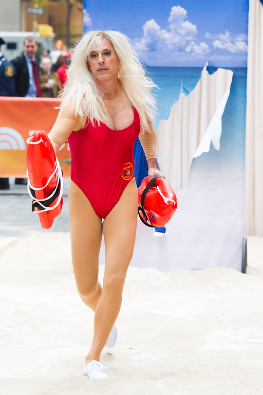 """. Matt Lauer dresses as C.J. Parker, a character played by Pam Anderson in \""""Baywatch\"""" on NBC\'s \""""Today\"""" Halloween show on Thursday, Oct. 31, 2013 in New York. (Photo by Charles Sykes/Invision/AP)"""
