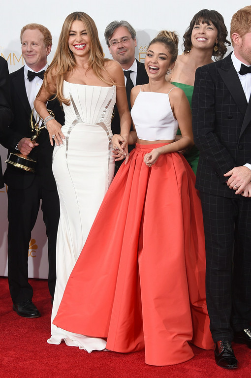 """. Actresses Sofía Vergara (L) and Sarah Hyland, winners of the Outstanding Comedy Series Award for \""""Modern Family\"""" pose in the press room during the 66th Annual Primetime Emmy Awards held at Nokia Theatre L.A. Live on August 25, 2014 in Los Angeles, California.  (Photo by Jason Merritt/Getty Images)"""