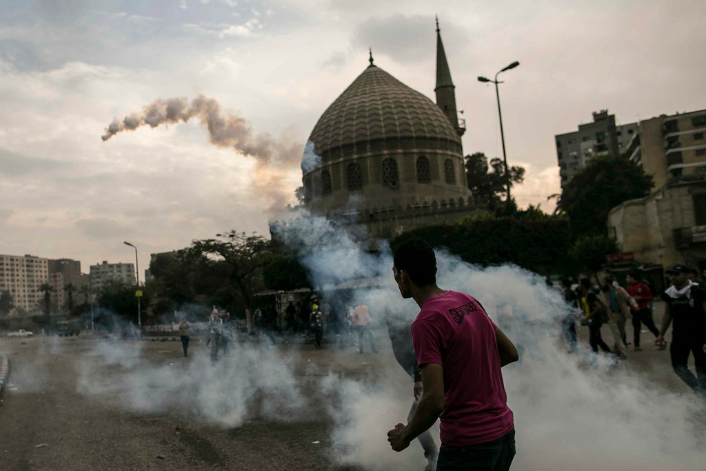 . Egyptian supporters of the Muslim Brotherhood stand amid tear gas during clashes with security forces near the Koubbeh Palace, in Cairo, Egypt, 29 November 2013. EPA/OSAMA ELSAYD/ALMASRY ALYOUM