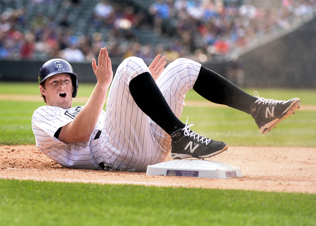 . DENVER, CO - JUNE 20: Colorado baserunner DJ Lemahieu reacted after he was picked off at first base in the ninth inning. The Milwaukee Brewers defeated the Colorado Rockies 9-4 at Coors Field Saturday afternoon, June 21, 2014. Photo by Karl Gehring/The Denver Post