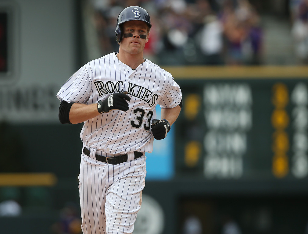. Colorado Rockies\' Justin Morneau circles the bases after hitting a two-run, walkoff home run against the San Diego Padres in the 10th inning of the Rockies\' 8-6 victory in 10 innings of a baseball game in Denver on Sunday, May 18, 2014. (AP Photo/David Zalubowski)
