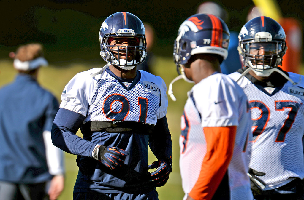 . Denver Broncos Robert Ayers (91)  warming up for the team practice at Dove Valley practice field, Englewood, Colorado, November 15, 2013. (Photo by Hyoung Chang/The Denver Post)