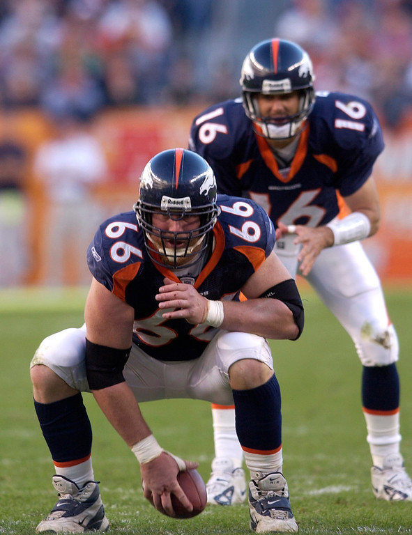 . Denver Bronco Center #66 Tom Nalen gets set to snap the ball to QB Jake Plummer during the game between the Denver Broncos and the Houston Texans at Invesco Field at Mile High in Denver, Co. on Sunday Nov. 7th, 2004.    DENVER POST PHOTO BY STEVE DYKES       DENVER BRONCOS