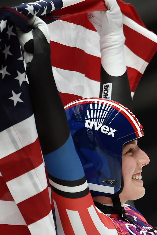 . US Erin Hamlin celebrates her bronze medal in the Women\'s Luge Singles event at the Sanki Sliding Center during the Sochi Winter Olympics on February 11, 2014.   LEON NEAL/AFP/Getty Images
