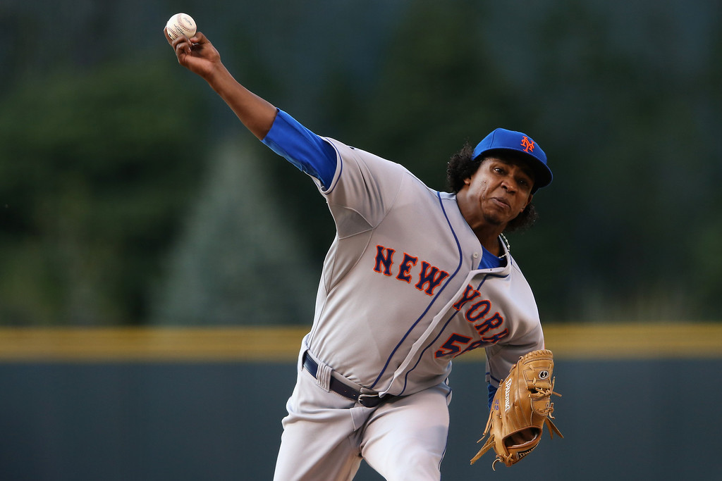 . DENVER, CO - MAY 03:  Starting pitcher Jenrry Mejia #58 of the New York Mets delivers against the Colorado Rockies at Coors Field on May 3, 2014 in Denver, Colorado.  (Photo by Doug Pensinger/Getty Images)