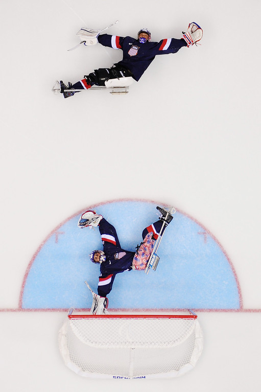 . United States goalkeepers Jen Lee (top) and Steve Cash warm up prior to the Ice Sledge Hockey Preliminary Round Group B match between the United States of America and Russia during day four of Sochi 2014 Paralympic Winter Games at Shayba Arena on March 11, 2014 in Sochi, Russia.  (Photo by Dennis Grombkowski/Getty Images)