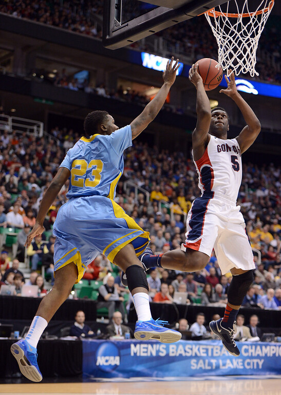 . SALT LAKE CITY, UT - MARCH 21:  Gary Bell, Jr. #5 of the Gonzaga Bulldogs goes up for a shot against YonDarius Johnson #23 of the Southern University Jaguars in the first half during the second round of the 2013 NCAA Men\'s Basketball Tournament at EnergySolutions Arena on March 21, 2013 in Salt Lake City, Utah.  (Photo by Harry How/Getty Images)