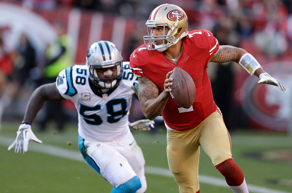 . San Francisco 49ers quarterback Colin Kaepernick (7) runs from Carolina Panthers outside linebacker Thomas Davis (58) during the fourth quarter of an NFL football game in San Francisco, Sunday, Nov. 10, 2013. (AP Photo/Ben Margot)