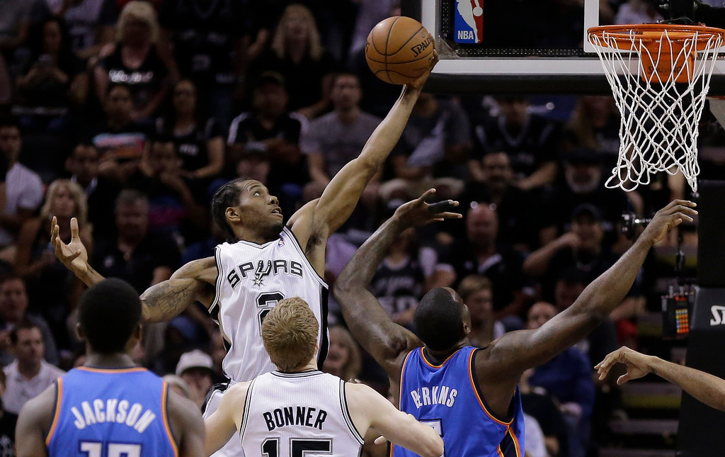 . Oklahoma City Thunder\'s Caron Butler (2) grabs a defensive rebound against the Oklahoma City Thunder during the first half of Game 5 of the Western Conference finals NBA basketball playoff series, Thursday, May 29, 2014, in San Antonio. (AP Photo/Eric Gay)