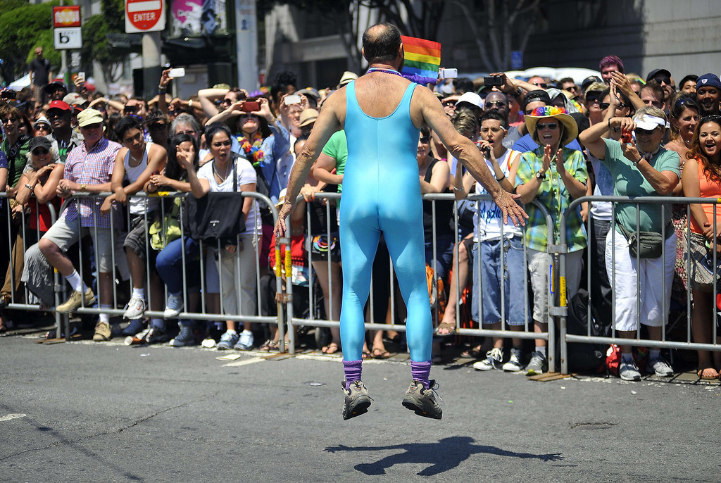 . A gay rights supporter jumps with excitement along the parade route at San Francisco\'s Gay Pride festival on June, 30, 2013.    Josh Edelson/AFP/Getty Images