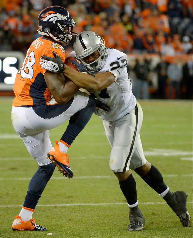 . Denver Broncos wide receiver Demaryius Thomas (88) recovers an on-side kick in the fourth quarter. The Denver Broncos took on the Oakland Raiders at Sports Authority Field at Mile High in Denver on September 23, 2013. (Photo by John Leyba/The Denver Post)