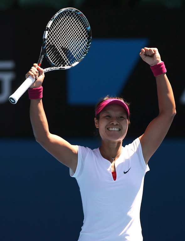 . Li Na of China celebrates after defeating Eugenie Bouchard of Canada  during their semifinal at the Australian Open tennis championship in Melbourne, Australia, Thursday, Jan. 23, 2014.(AP Photo/Aaron Favila)