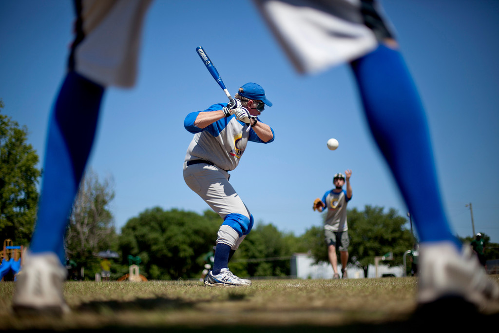 """. Roger Keeney prepares to hit a ball during a blind baseball game in Albany, Ga. on May 5, 2012. \""""When they get up there and once they\'ve connected with it once, for most of them, they\'re hooked. It\'s a rush you will never forget. Do the impossible and then nothing is impossible,\"""" he says. (AP Photo/David Goldman)"""