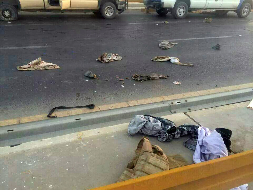 . A picture taken with a mobile phone shows uniforms reportedly belonging to Iraqi security forces scattered on the road on June 10, 2014,  after hundreds of militants from the Islamic State of Iraq and the Levant (ISIL) launched a major assault on the security forces in Mosul, some 370 kms north from the Iraqi capital Baghdad. Some 500,000 Iraqis have fled their homes in Iraq\'s second city Mosul after Jihadist militants took control, fearing increased violence, the International Organization for Migration said. STR/AFP/Getty Images