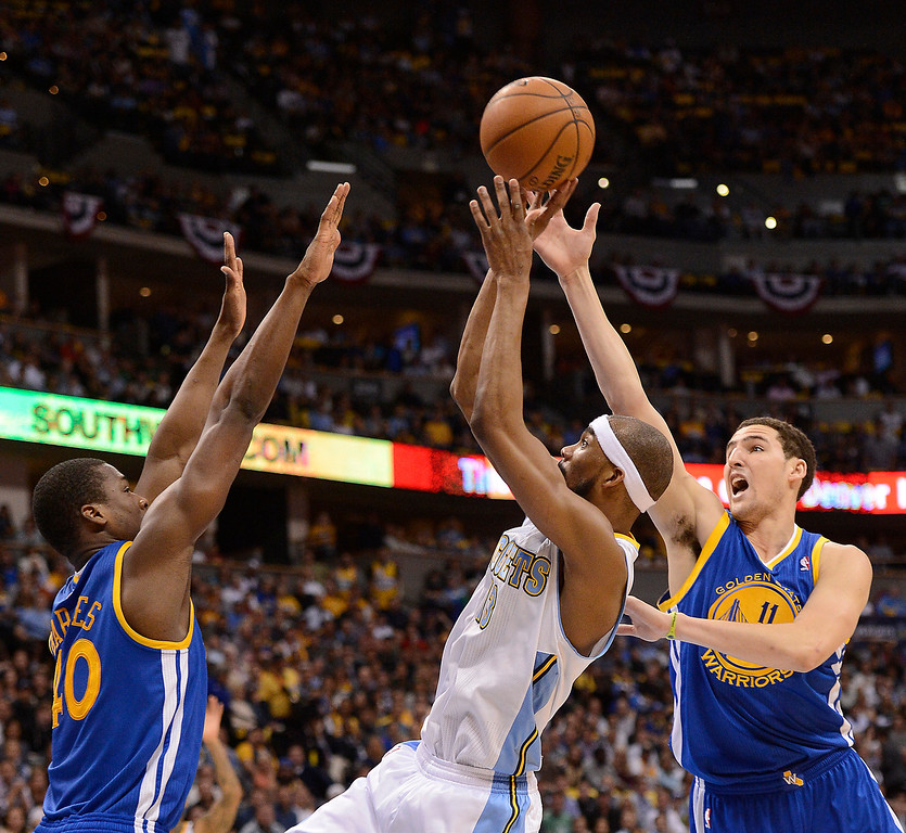 . Denver Nuggets small forward Corey Brewer (13) puts up a shot against Golden State Warriors shooting guard Klay Thompson (11) and Golden State Warriors small forward Harrison Barnes (40) in the second quarter. The Denver Nuggets took on the Golden State Warriors in Game 5 of the Western Conference First Round Series at the Pepsi Center in Denver, Colo. on April 30, 2013. (Photo by John Leyba/The Denver Post)
