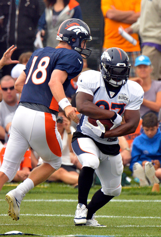 . Denver Broncos QB Peyton Manning (18) hands off to Knowshon Moreno (27) during training camp July 29, 2013 at Dove Valley. (Photo By John Leyba/The Denver Post)