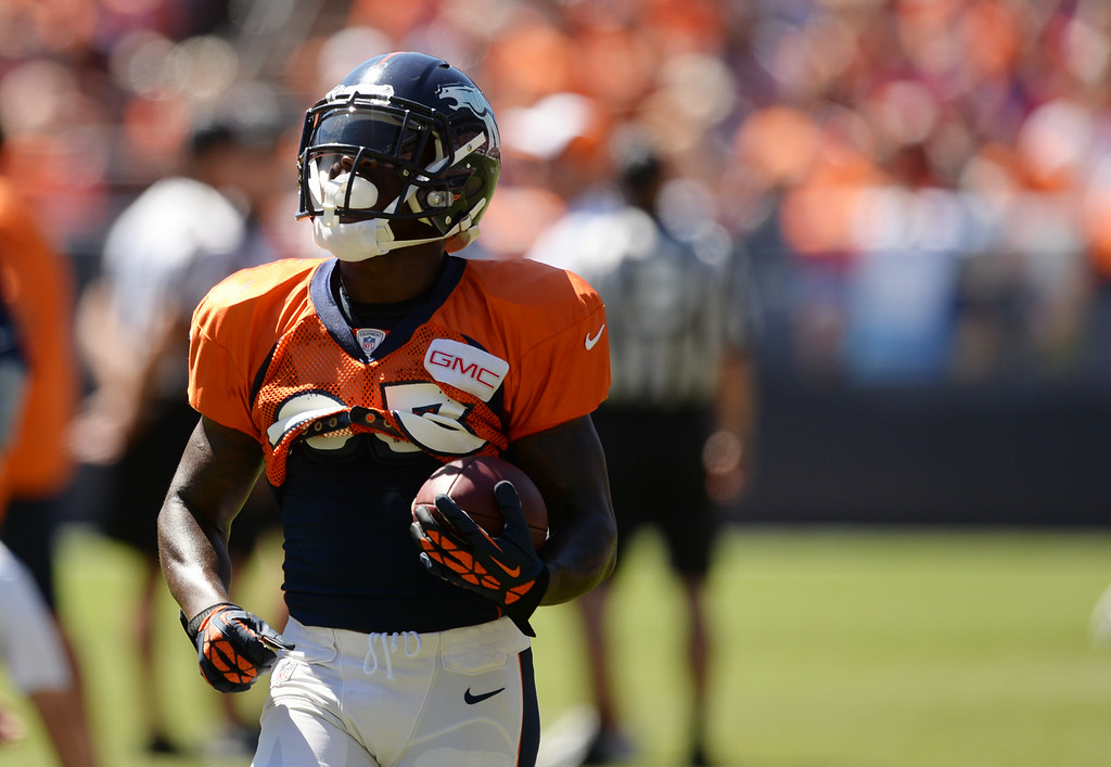 . Ronnie Hillman of Denver Broncos (23) is warming up for the Broncos scrimmage at Sports Authority Field at Mile High. Denver, Colorado. August 02. 2014. (Photo by Hyoung Chang/The Denver Post)