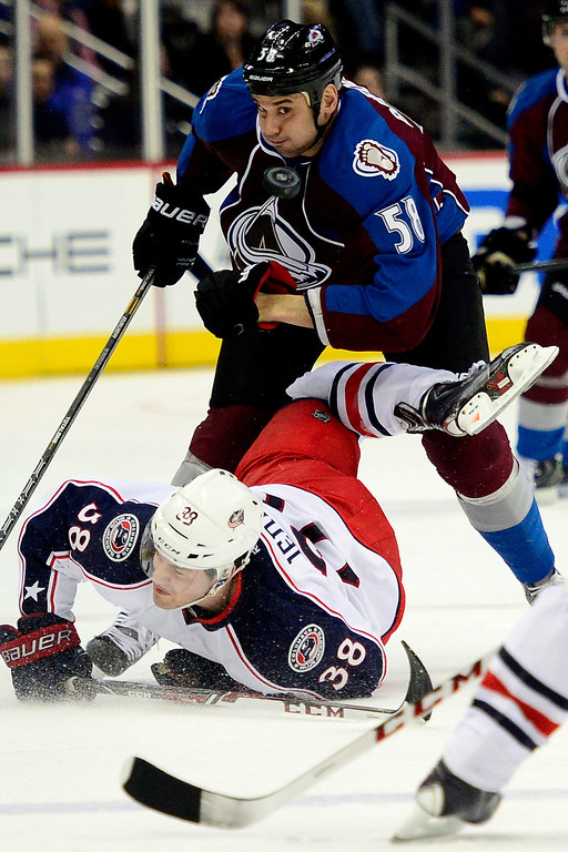 . Patrick Bordeleau (58) of the Colorado Avalanche gives the business to Boone Jenner (38) of the Columbus Blue Jackets during the this period of Colorado\'s 5-3 win  (Photo by AAron Ontiveroz/The Denver Post)
