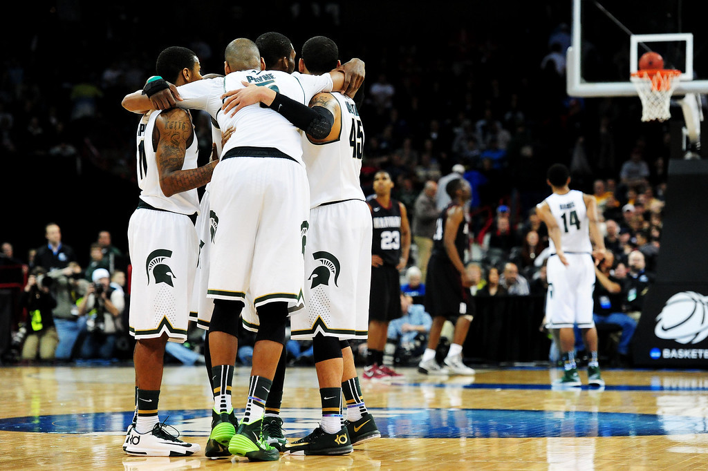 . SPOKANE, WA - MARCH 22:  The Michigan State Spartans huddle as Gary Harris #14 shoots free-throws at the end of their game against the Harvard Crimson during the Third Round of the 2014 NCAA Basketball Tournament at Spokane Veterans Memorial Arena on March 22, 2014 in Spokane, Washington.  (Photo by Steve Dykes/Getty Images)