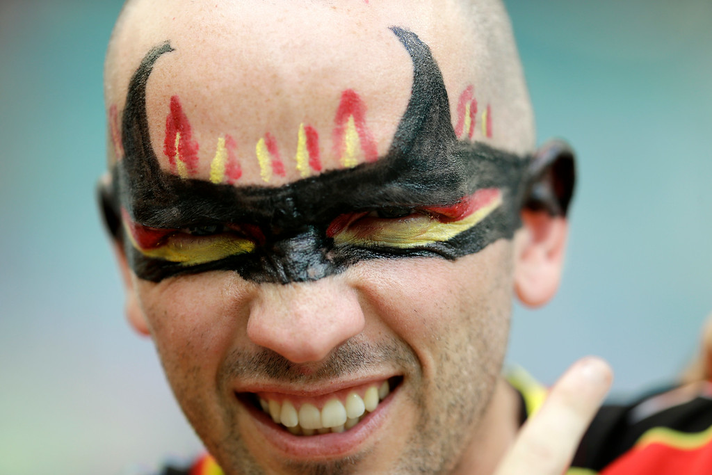 . A Belgium supporter shows off his face paint before the World Cup round of 16 soccer match between Belgium and the USA at the Arena Fonte Nova in Salvador, Brazil, Tuesday, July 1, 2014. (AP Photo/Natacha Pisarenko)
