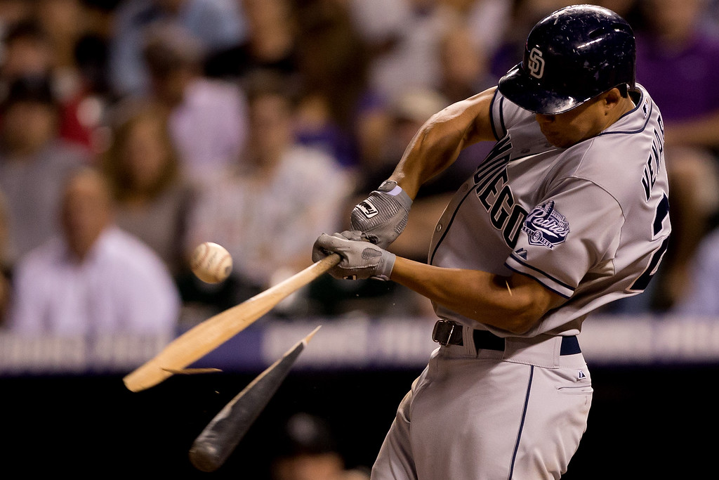 . Will Venable #25 of the San Diego Padres breaks his bat on an RBI single during the sixth inning against the Colorado Rockies at Coors Field on August 13, 2013 in Denver, Colorado.  The Padres defeated the Rockies 7-5.  (Photo by Justin Edmonds/Getty Images)