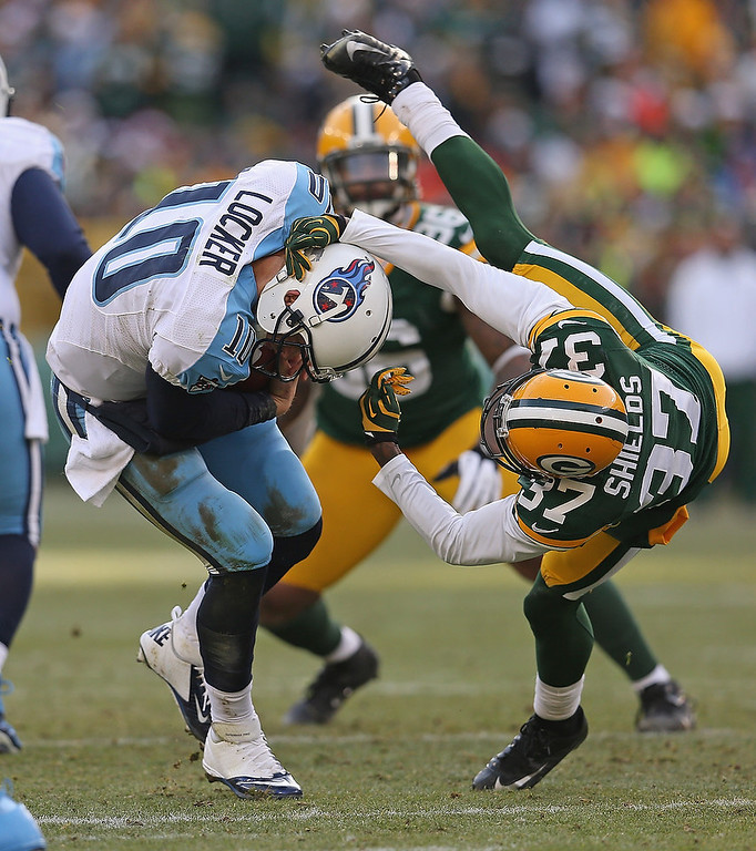 . Sam Shields #37 of the Green Bay Packers sacks Jake Locker #10 of the Tennessee Titans at Lambeau Field on December 23, 2012 in Green Bay, Wisconsin. The Packers defeated the Titans 55-7. (Photo by Jonathan Daniel/Getty Images)