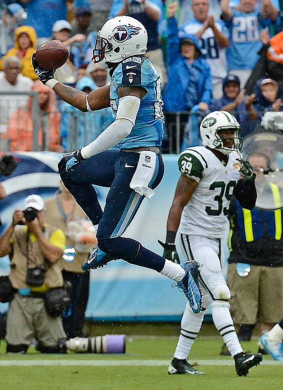 . Tennessee Titans wide receiver Nate Washington (85) celebrates after scoring a touchdown on a 4-yard pass play against the New York Jets in the second quarter of an NFL football game on Sunday, Sept. 29, 2013, in Nashville, Tenn. New York Jets free safety Antonio Allen (39) is at right. (AP Photo/Mark Zaleski)