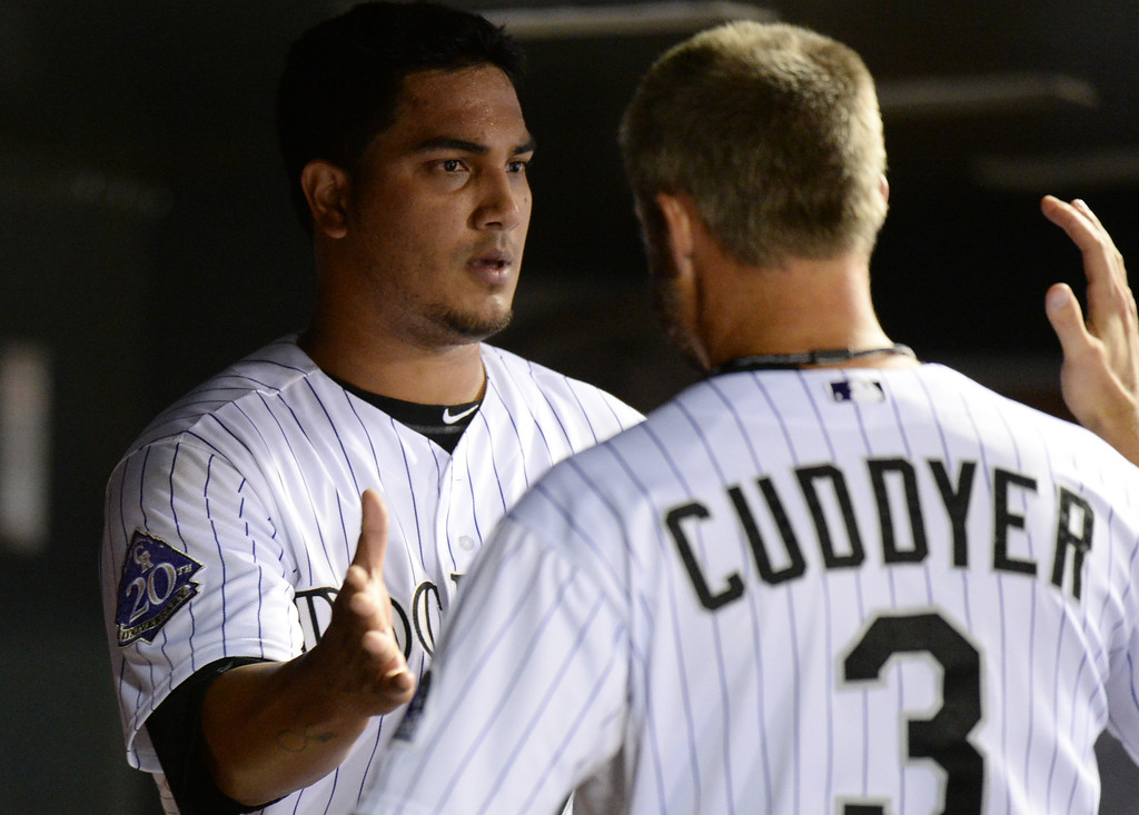 . DENVER, CO. - June 28: Michael Cuddyer of Colorado Rockies (3), right, hugs Jhoulys Chacin (45)  after Chacin pitched 8 inning against San Francisco Giants at Coors Field. Denver, Colorado. June 28, 2013. Colorado won 4-1. (Photo By Hyoung Chang/The Denver Post)