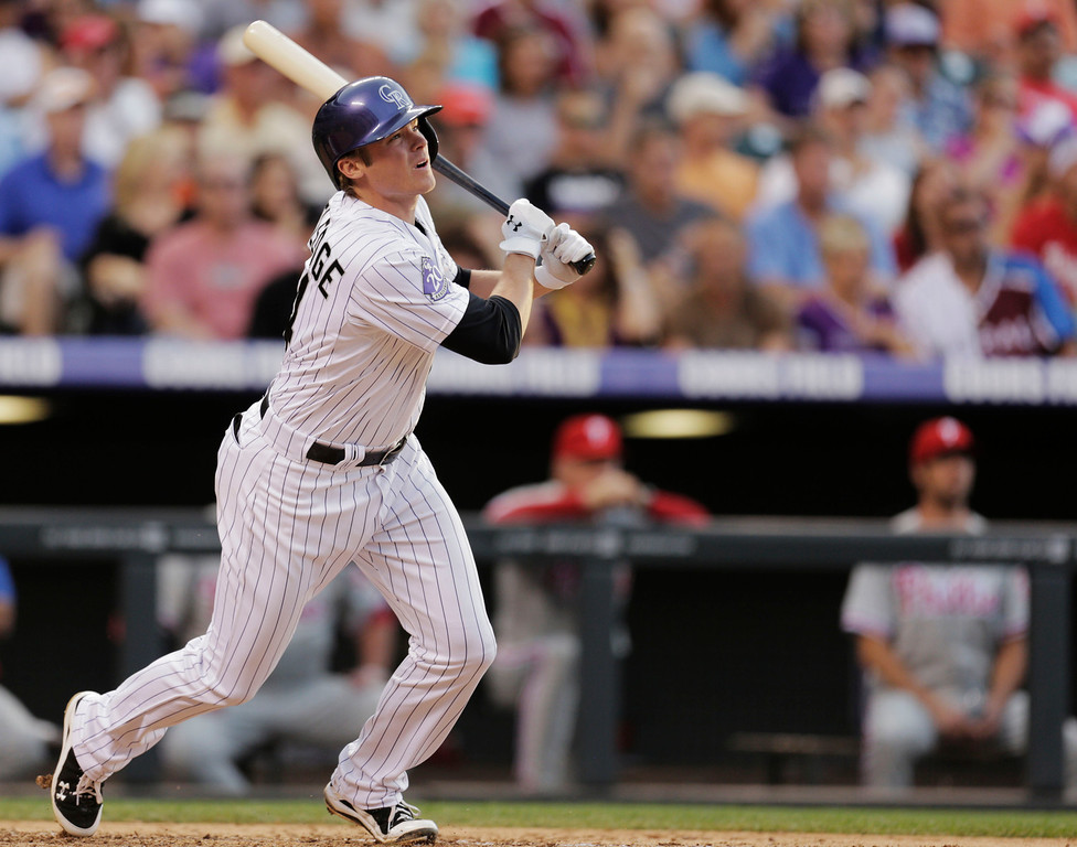 . Colorado Rockies\' Josh Rutledge hits a two-run home run against the  Philadelphia Phillies in the fourth inning of a baseball game on Friday, June 14, 2013, in Denver. (AP Photo/Joe Mahoney)