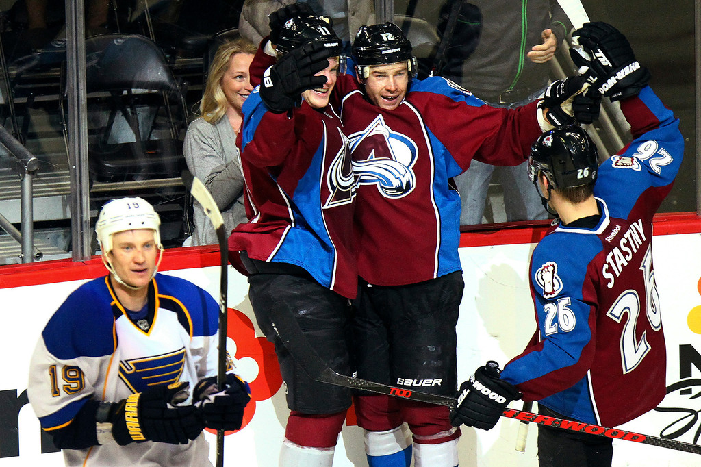 . Colorado Avalanche\'s Chuck Kobasew, center, celebrates his goal with Jamie McGinn (11) and Paul Stastny (26) during the third period of an NHL hockey game against the St. Louis Blues, Sunday, April 21, 2013, in Denver. The Avalanche won 5-3. (AP Photo/Barry Gutierrez)