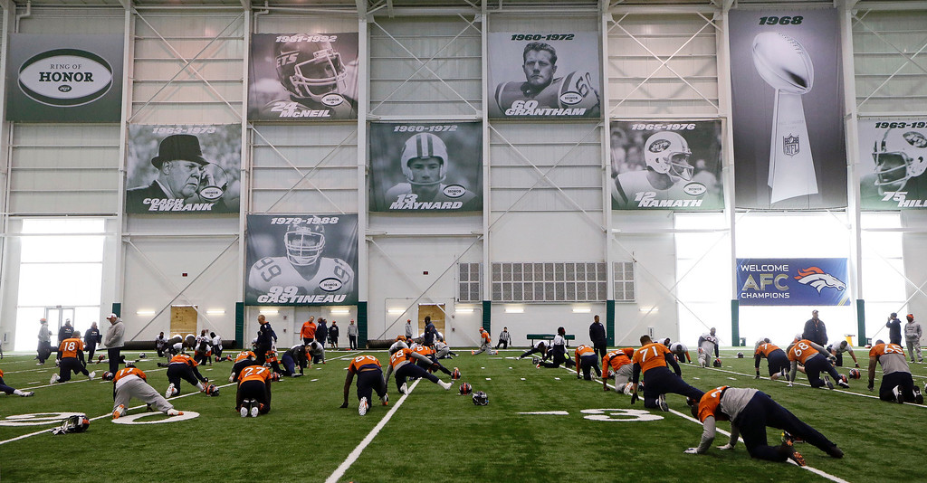 . Denver Broncos players stretch during practice at the New York Jets facility Thursday, Jan. 30, 2014, in Florham Park, N.J. The Broncos are scheduled to play the Seattle Seahawks in the NFL Super Bowl XLVIII football game Sunday, Feb. 2, in East Rutherford, N.J. (AP Photo)
