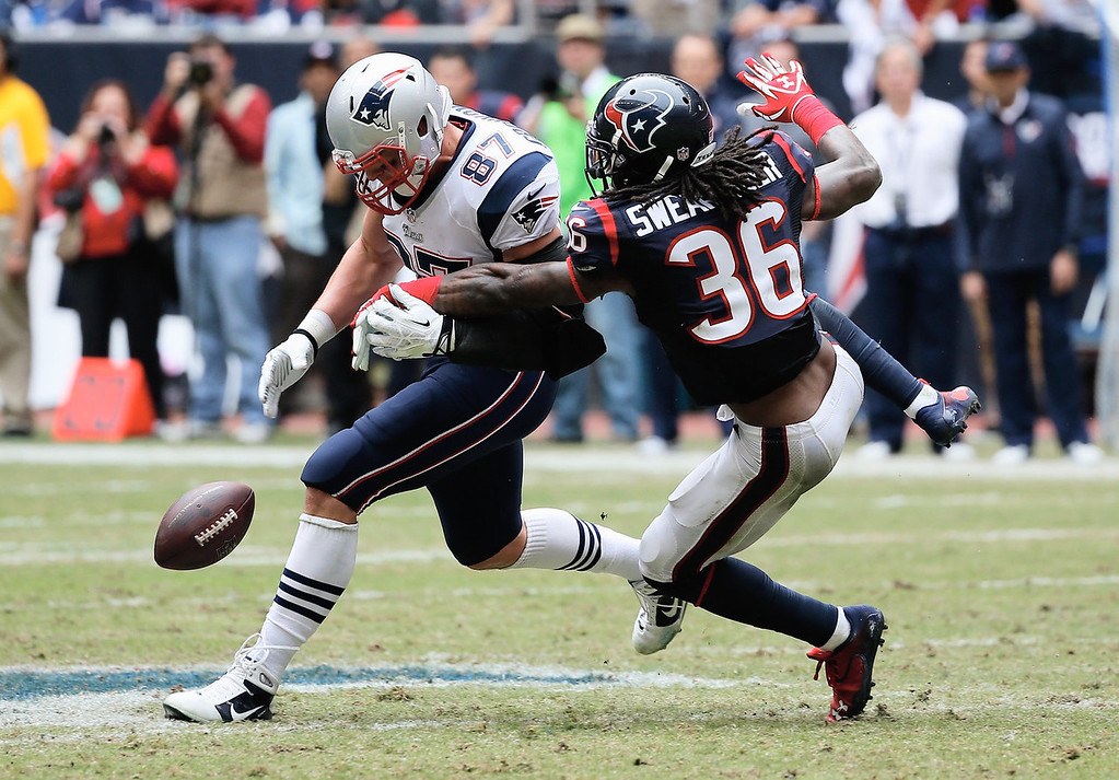 . Rob Gronkowski #87 of the New England Patriots reaches for a pass in front of  D.J. Swearinger#36 of the Houston Texans at Reliant Stadium on December 1, 2013 in Houston, Texas.  (Photo by Scott Halleran/Getty Images)