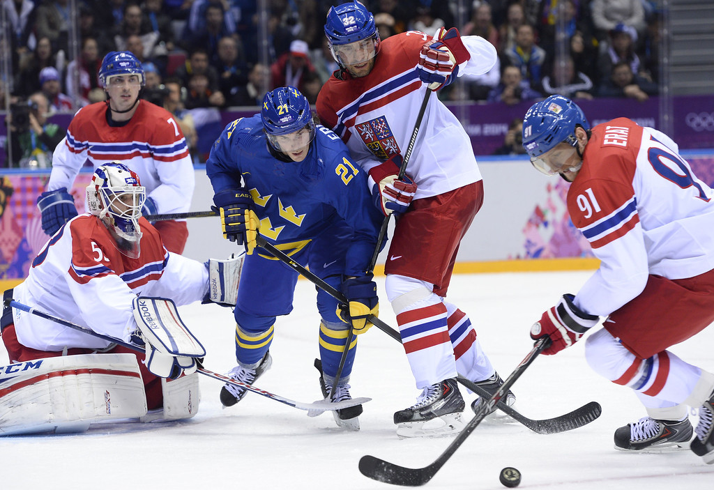 . Sweden\'s Loui Eriksson (C) vies with Czech Republic\'s goalkeeper Alexander Salak, Czech Republic\'s Michal Rozsival (2ndR) and Czech Republic\'s Martin Erat (R) during the Men\'s Ice Hockey Group C match Czech Republic vs Sweden at the Bolshoy Arena during the Sochi Winter Olympics on February 12, 2014. JONATHAN NACKSTRAND/AFP/Getty Images