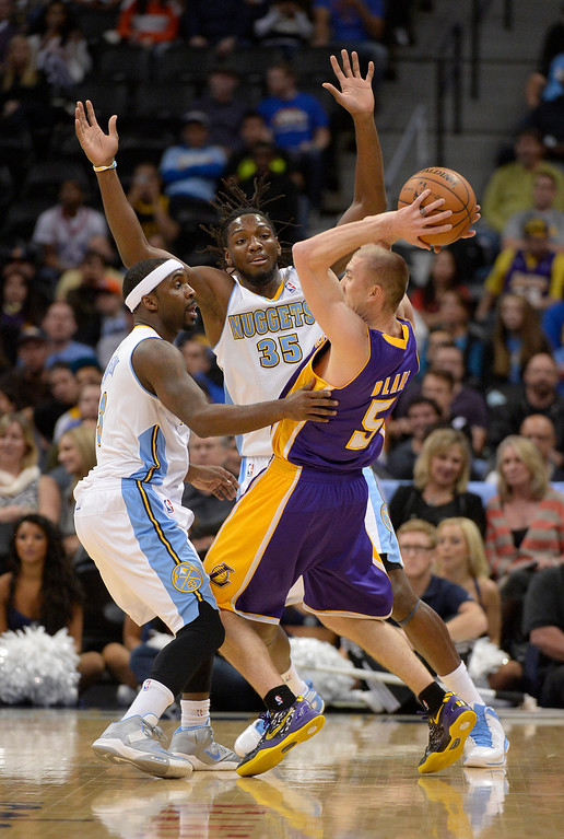 . DENVER, CO - NOVEMBER 13: Los Angeles Lakers point guard Steve Blake (5) gets trapped by Denver Nuggets point guard Ty Lawson (3) and Denver Nuggets power forward Kenneth Faried (35) during the first quarter November 13, 2013 at Pepsi Center. (Photo by John Leyba/The Denver Post)