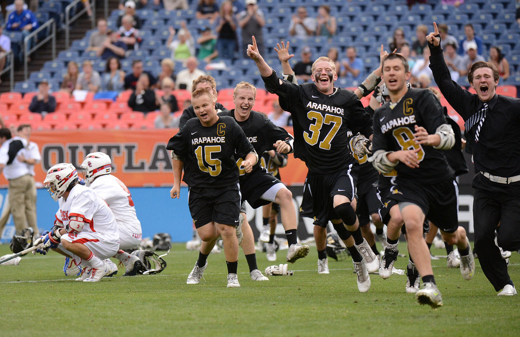 . DENVER, CO. - MAY 18 : Arapahoe High School players celebrate winning of 5A Boy\'s Lacrosse Championship game against Cherry Creek High School at Sports Authority Field at Mile High Stadium. Denver, Colorado. May 18, 2013. (Photo By Hyoung Chang/The Denver Post)