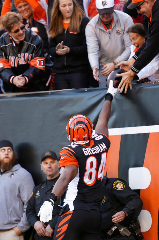 . Cincinnati Bengals tight end Jermaine Gresham (84) hands a football to a fan after catching a four-yard touchdown pass in the first half of an NFL football game against the New York Jets, Sunday, Oct. 27, 2013, in Cincinnati. (AP Photo/David Kohl)