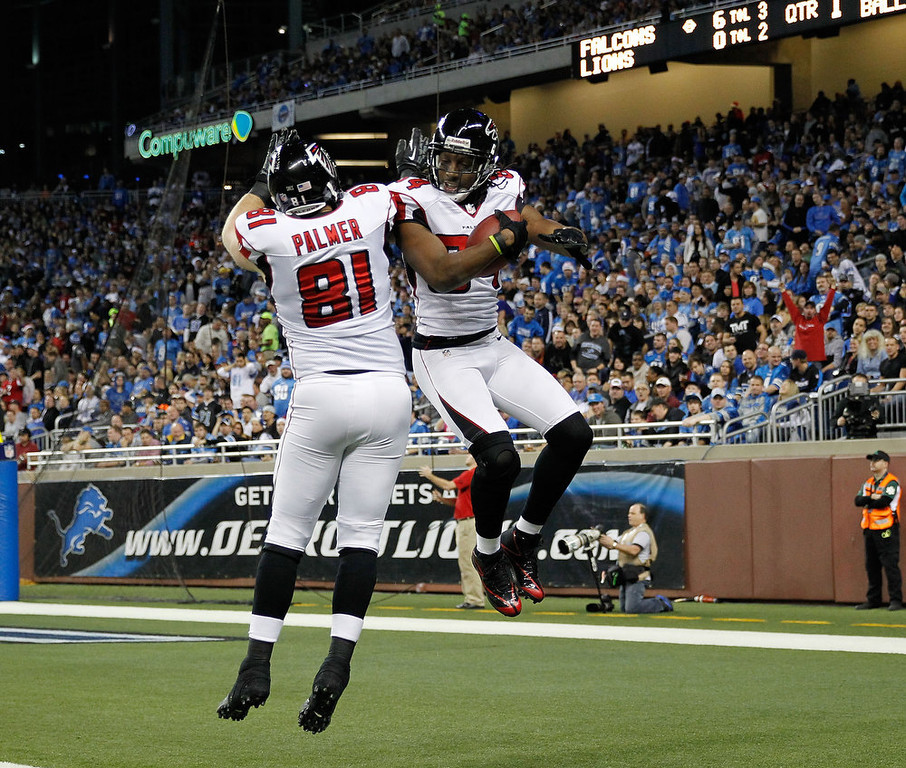 . Roddy White #84 of the Atlanta Falcons celebrates a first quarter touchdown with Michael Palmer #81 while playing the Detroit Lions at Ford Field on December 22, 2012 in Detroit, Michigan. (Photo by Gregory Shamus/Getty Images)