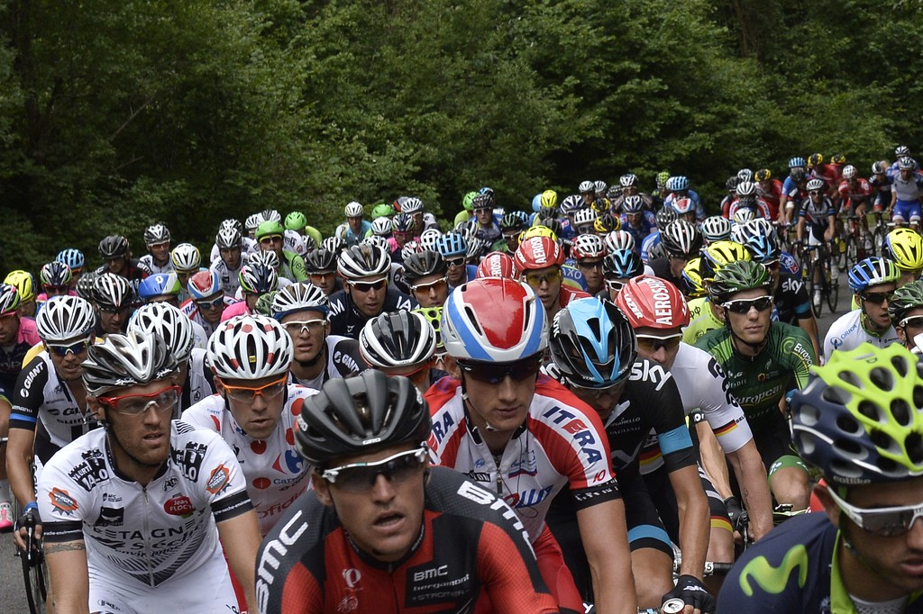 . The pack rides during the 234.5 km seventh stage of the 101st edition of the Tour de France cycling race on July 11, 2014 between Epernay and Nancy, northeastern France.  AFP PHOTO / JEFF PACHOUD/AFP/Getty Images