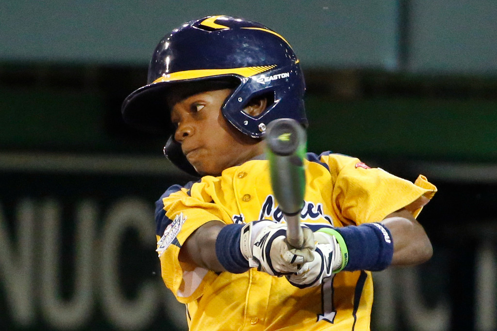 . Chicago\'s DJ Butler drives in two runs with a single in the first inning off Philadelphia\'s Erik Lipson during an elimination baseball game at the Little League World Series in South Williamsport, Pa., Thursday, Aug. 21, 2014. (AP Photo/Gene J. Puskar)