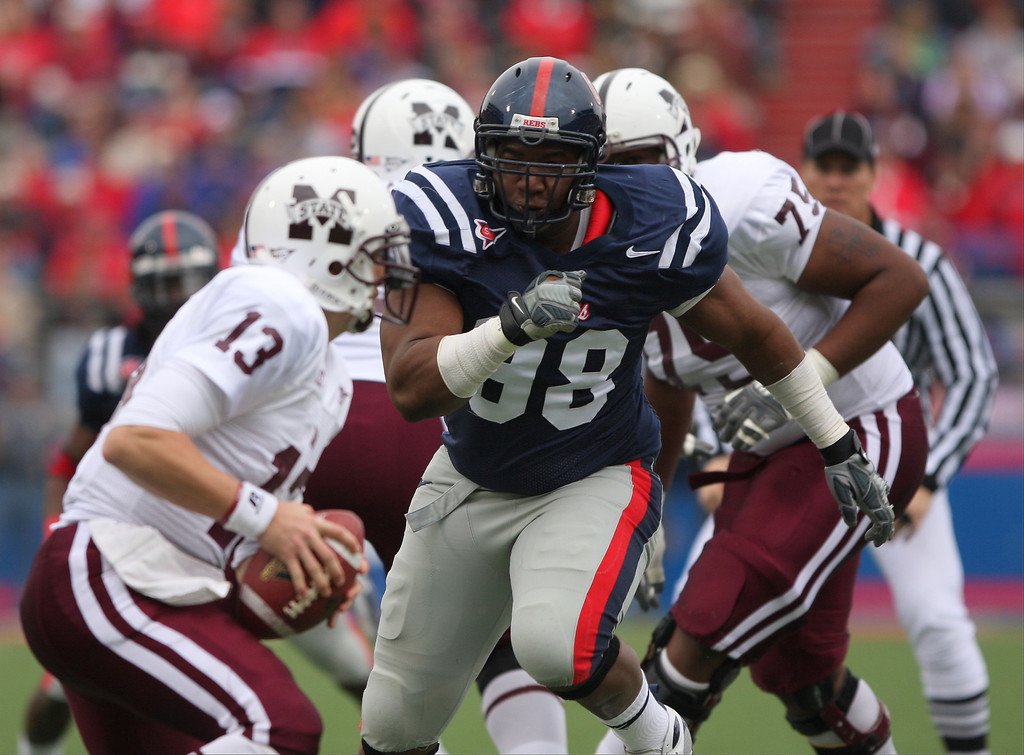 . Peria Jerry #98 of the Ole Miss Rebels chases Wesley Carroll #13 of the Mississippi State Bulldogs during their game at Vaught-Hemingway Stadium on November 28, 2008 in Oxford, Mississippi.  (Photo by Matthew Sharpe/Getty Images)