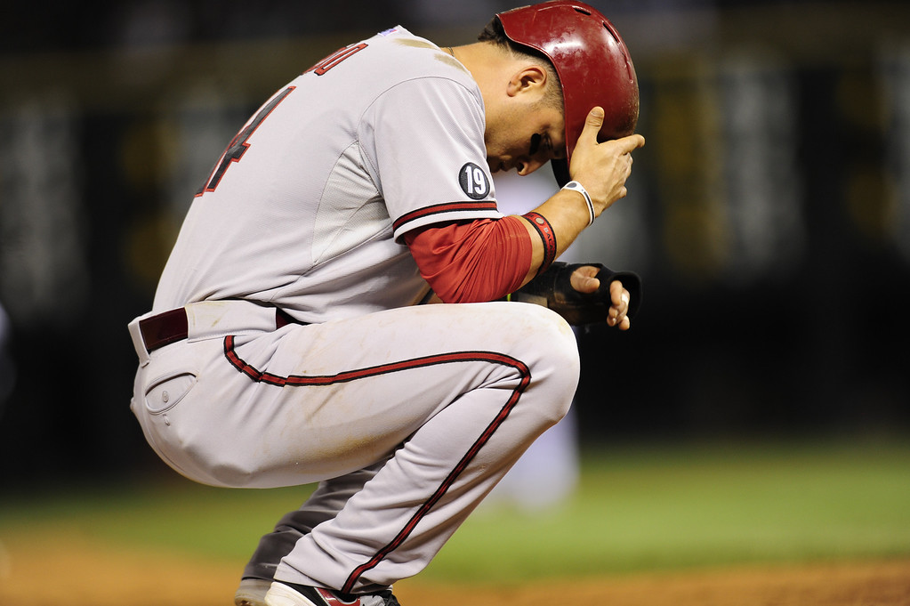 . DENVER, CO. - SEPT 20, 2013:   Martin Prado pauses during the game on third base. The Diamondbacks lost 4-9 tonight against the Rockies.   (Photo By Erin Hull/The Denver Post)