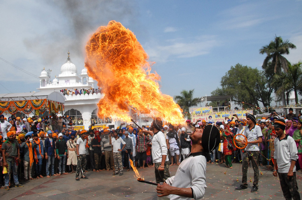 . An Indian Sikh devotee performs fire-breathing during a religious procession to mark Holla Mohalla at the Guru Dwara Sri Kesgarh Sahib temple at Sri Anandpur Sahib, some 100 kms from Jalandhar, on March 17, 2014. Hola Mohalla is a three day Sikh festival, in which Nihang Sikh \'warriors\' perform Gatka (mock encounters with real weapons), tent pegging and bareback horse-riding, which usually falls in March following the Hindu festival of Holi. AFP PHOTO/SHAMMI MEHRA/AFP/Getty Images