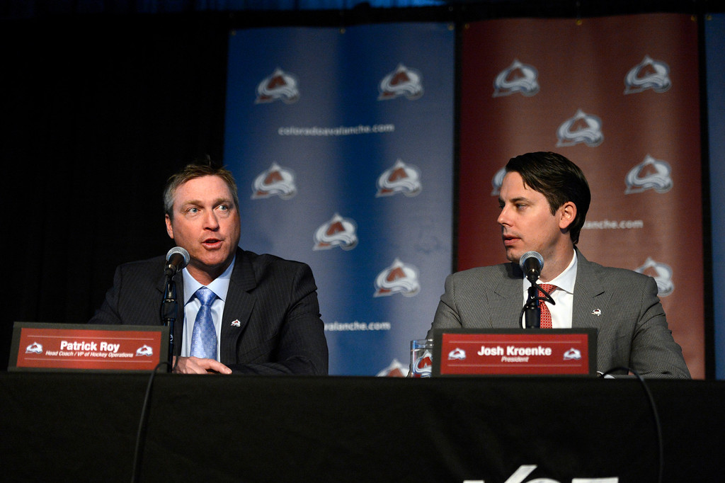 . Patrick Roy answers questions from the media as Avalanche President Josh Kroenke looks on during the press conference announcing Roy as the new head coach and president of operations for the team. (Photo By John Leyba/The Denver Post)