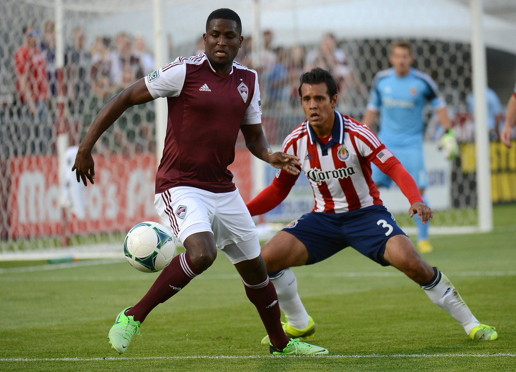 . COMMERCE CITY, CO. - MAY 25: Edson Buddle of Colorado Rapids controls the ball against Mario de Luna of Chivas USA (3) in the 1st half of the game at Dick\'s Sporting Goods Park. Commerce City, Colorado. May 25, 2013. (Photo By Hyoung Chang/The Denver Post)