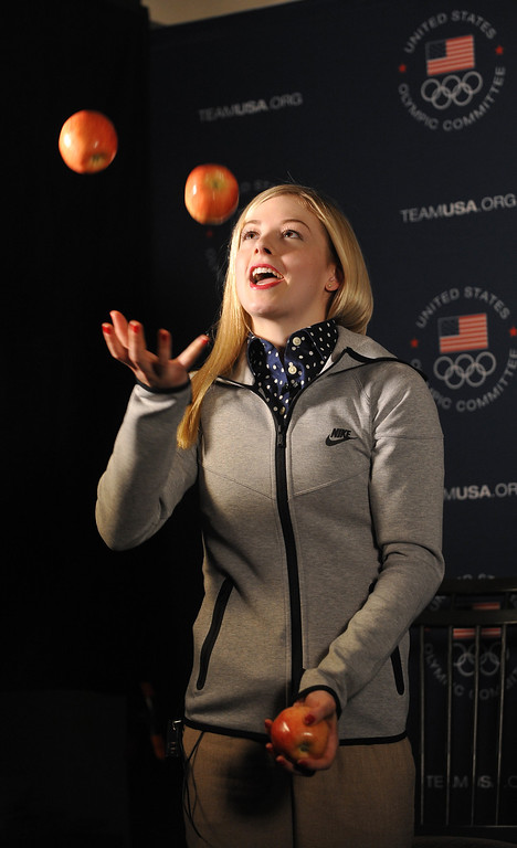 . U.S. Olympic figure skater Gracie Gold juggles apples for an interview during the USOC Media Summit ahead of the Sochi 2014 Winter Olympics on September 30, 2013 in Park City, Utah.  (Photo by Gene Sweeney Jr/Getty Images)